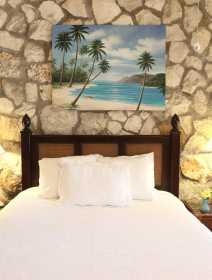 Queen Size bed in Tamarind Suite